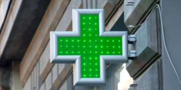 Green sign of the Red Cross